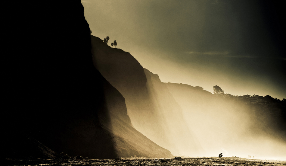 """I believe this is Tim Tebow just moments before paddling out at Blacks Beach. One of those days when the mist from the waves get pushed against the cliffs to make for some dramactic light. Easily one of my favorite beaches in the world. Photo: <a href=\""""http://9mphoto.com/\"""" target=_blank>Myles McGuinness</a>"""