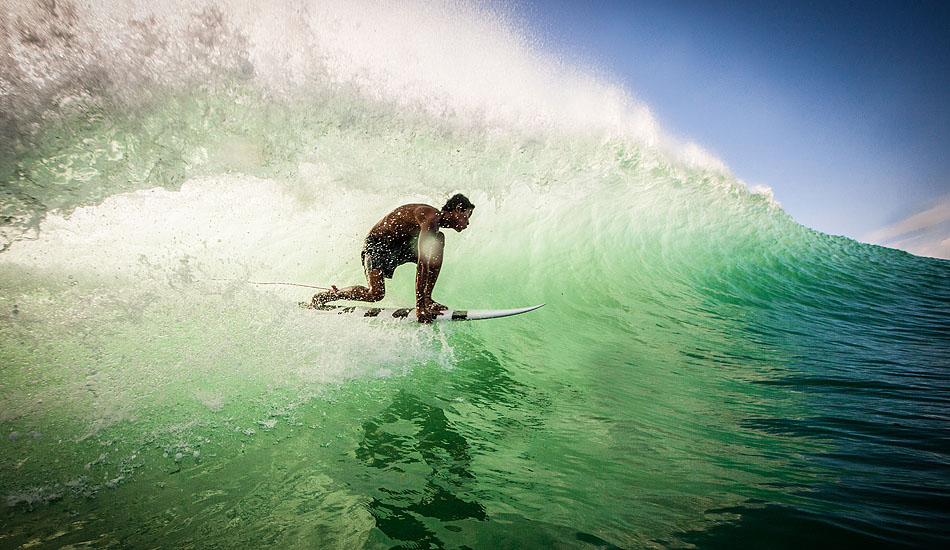 """Skip the sunset mojitos with Bali\'s white linen crowd and get over to the Bukit to catch the best light of the day shining through a wall of Indian Ocean perfection like this one that Nyoman \'Blacky\' caught at Bingin. Photo: <a href= \""""http://tommyschultz.com/blog/category/photo-galleries/surf-photography-2/\"""">Tommy Schultz</a>"""