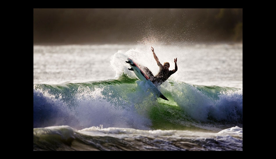 """An unknown surfer blowing out the tail on a really nice evening at home. Photo: <a href=\""""http://www.kevinvphotos.com\"""" target=_blank>KevinVPhotos.com</a>"""