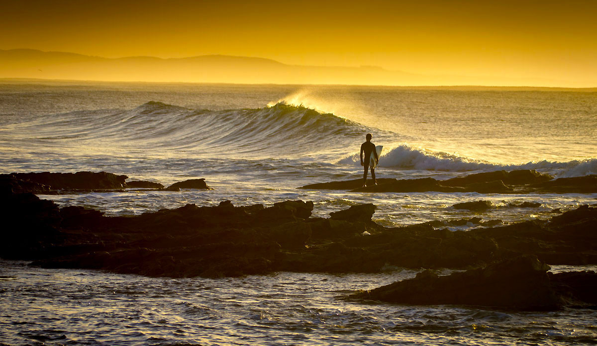 "Local grom first out at Wild Coast Point. Winter offshores. Photo: <a href=""https://www.facebook.com/pages/Pho-Tye-Studio/398591356893177?fref=nf\""> Tyerell Jordaan</a>"