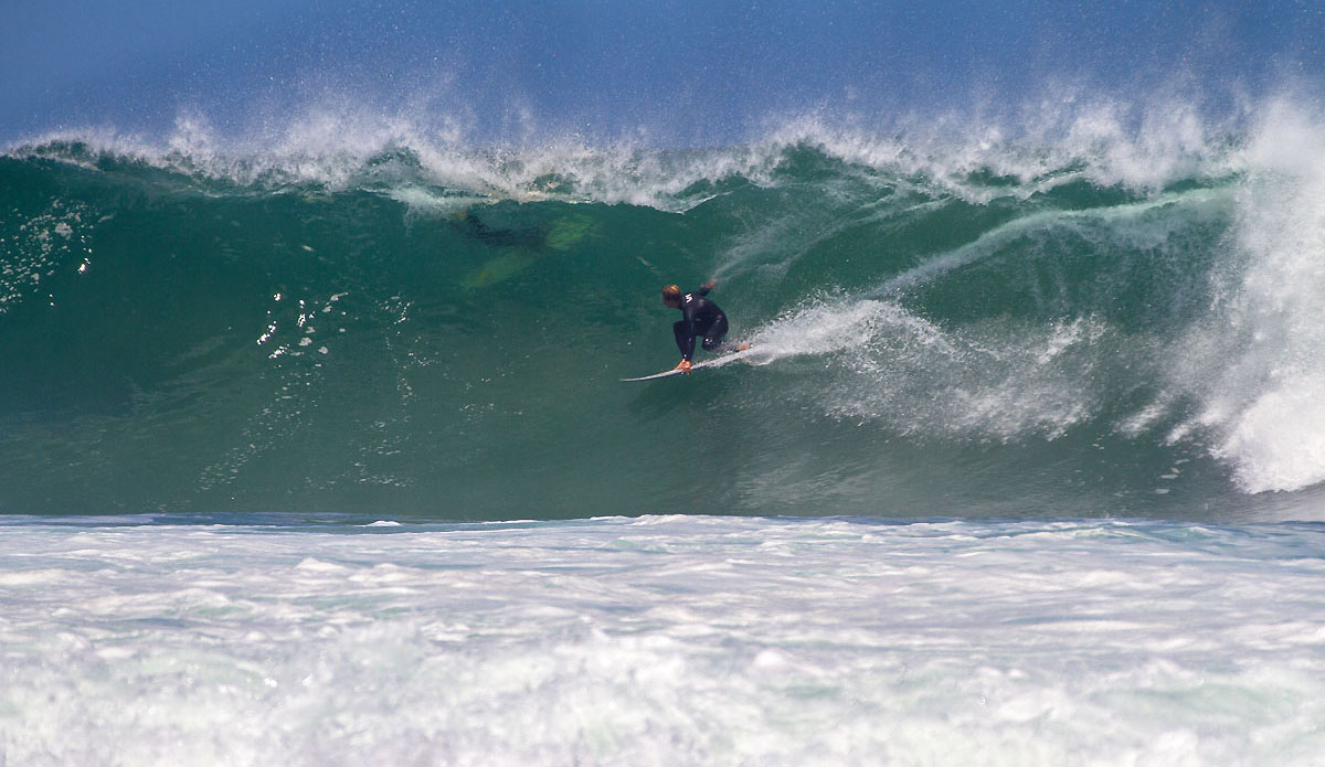 Simon Fish locked in on the point. It\'s super powerful wave that comes from deep water and throws itself over the reef.