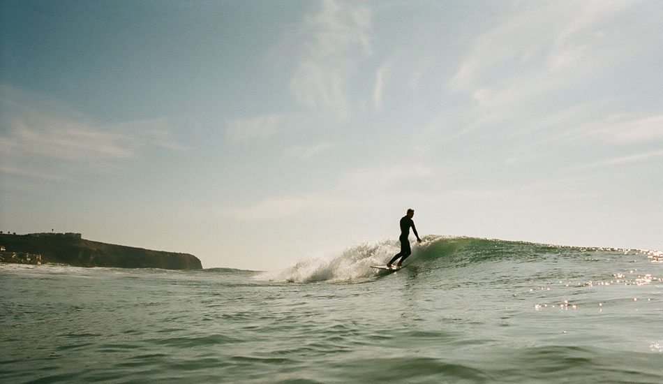 """): John Wesley surfing at his home break in Southern California. John has been producing high quality boards for a few years now. Lately, he's been focusing on quality over quantity. Photo: <a href=\""""http://tenpiggiesover.blogspot.com\"""">Alex Swanson</a>"""