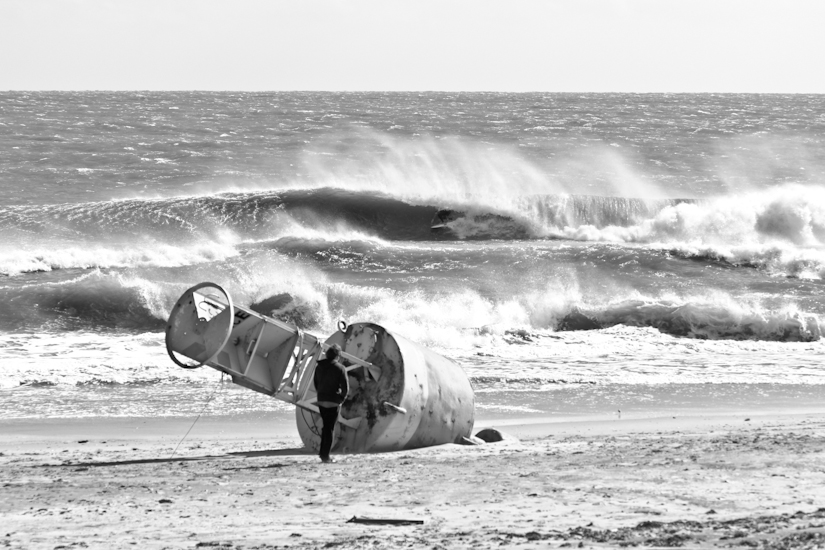 "S Turns. OBX, NC 2011. Charlie Weatherby tucked into a drainer. Since Hurricane Sandy, this spot no longer exists. Photo: <a href=""http://www.chrisfrickphotography.com/\"" target=_blank>Chris Frick</a>"
