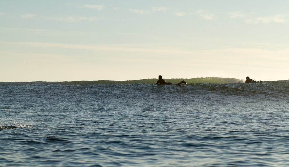 """Paddling back out and the swell keeps pumping.  Photo: <a href=\""""http://lowtiderising.com\"""">Aroyan/lowtiderising.com</a>"""