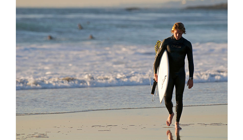 """Surfer Henry McNamara thoroughly exhausted after a long day of wave hunting around Orange County. Henry\'s now at school in Hawaii, regularly torturing me with images of warm, clear water and hollow waves. Photo: <a href=\""""http://driftwoodfoto.com/\"""">Ben Ginsberg</a>"""