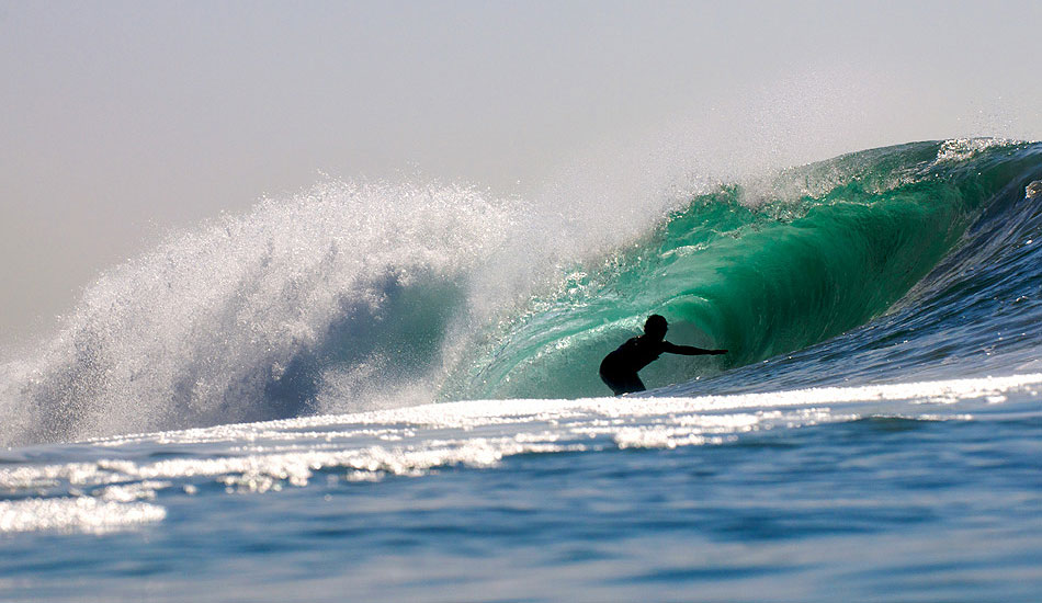 """I love using a long telephoto lens when I shoot from the water. Local surfer finds some shade in a drainer in Newport Beach, CA. Photo: <a href=\""""http://driftwoodfoto.com/\"""">Ben Ginsberg</a>"""