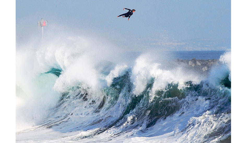 """Bobby Okvist airing it out over a triple-overhead wave at Newport Beach\'s The Wedge. I\'m incredibly honored that this image placed Top 50 Overall, and Top 5 in the Wings category, for the 2013 Red Bull Illume contest. Photo: <a href=\""""http://driftwoodfoto.com/\"""">Ben Ginsberg</a>"""