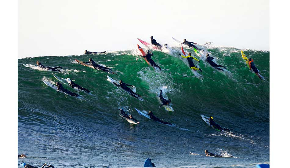 "Local big wave surfer Wyatt Fields digs deep for a set while a who\'s who of big wave surfing scratches to paddle to safety at Mavericks. Photo: <a href=""http://driftwoodfoto.com/\"">Ben Ginsberg</a>"