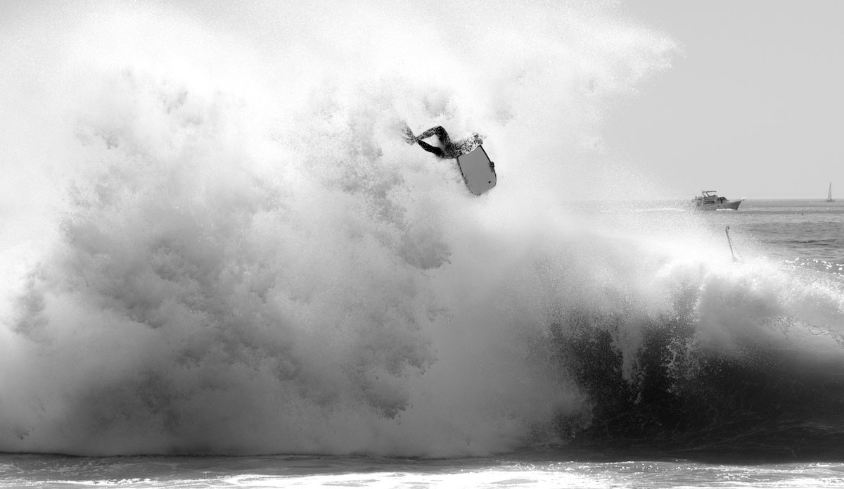 """An unknown bodyboarder gets tossed in a backwash explosion. These guys take the hardest, most regular beatings of anyone out there. Photo: <a href=\""""http://www.driftwoodfoto.com/\"""">Benjamin Ginsberg</a>"""