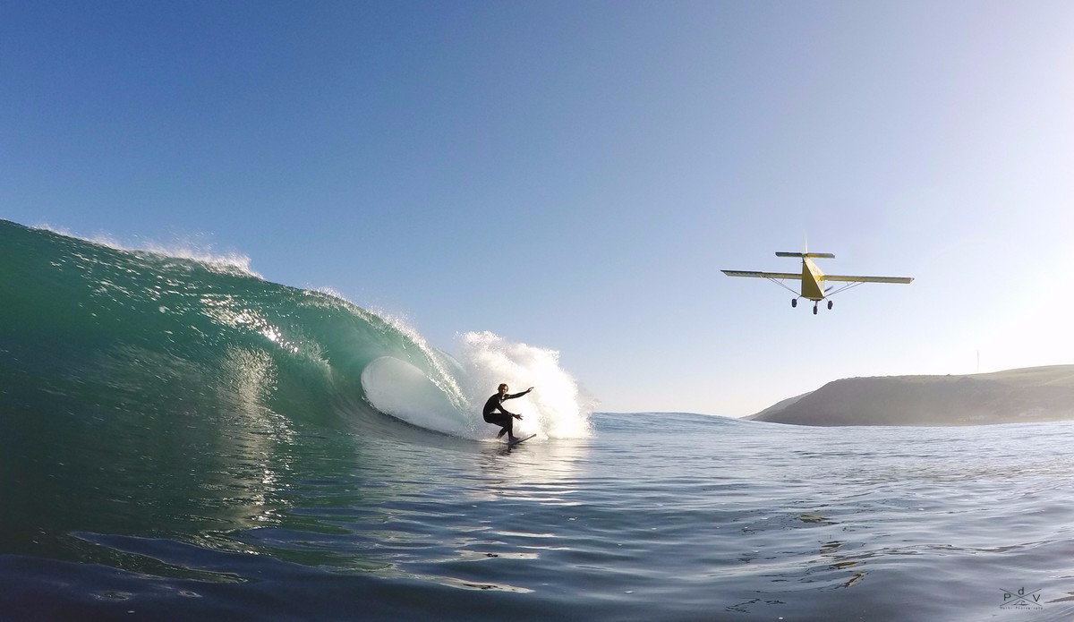 """Simon Fish maintains his composure as a low flying plane gets within a couple of meters. This is one of my favorite images and is truly a once in a lifetime shot. Photo: <a href=\""""https://www.facebook.com/pages/Pierre-de-Villiers-Water-Photography/810937898938872\"""">Pierre de Villiers</a>"""
