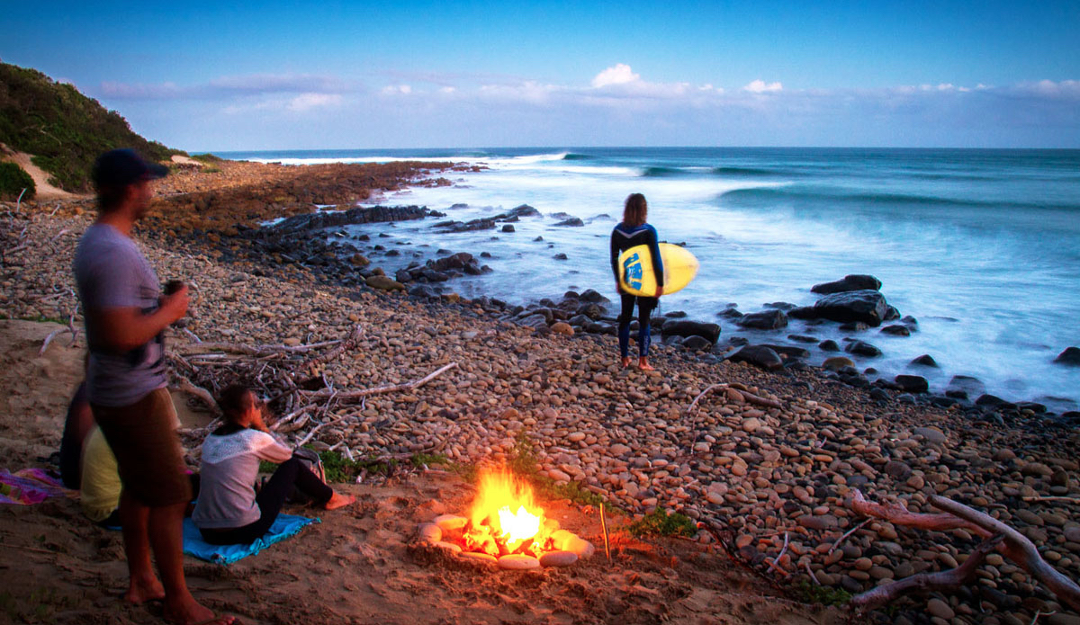 """Surf all day and warm up around the fire. Wild Coast life is simple but awesome.  Photo: <a href=\""""https://www.facebook.com/pages/Pho-Tye-Studio/398591356893177?fref=nf\""""> Tyerell Jordaan</a>"""