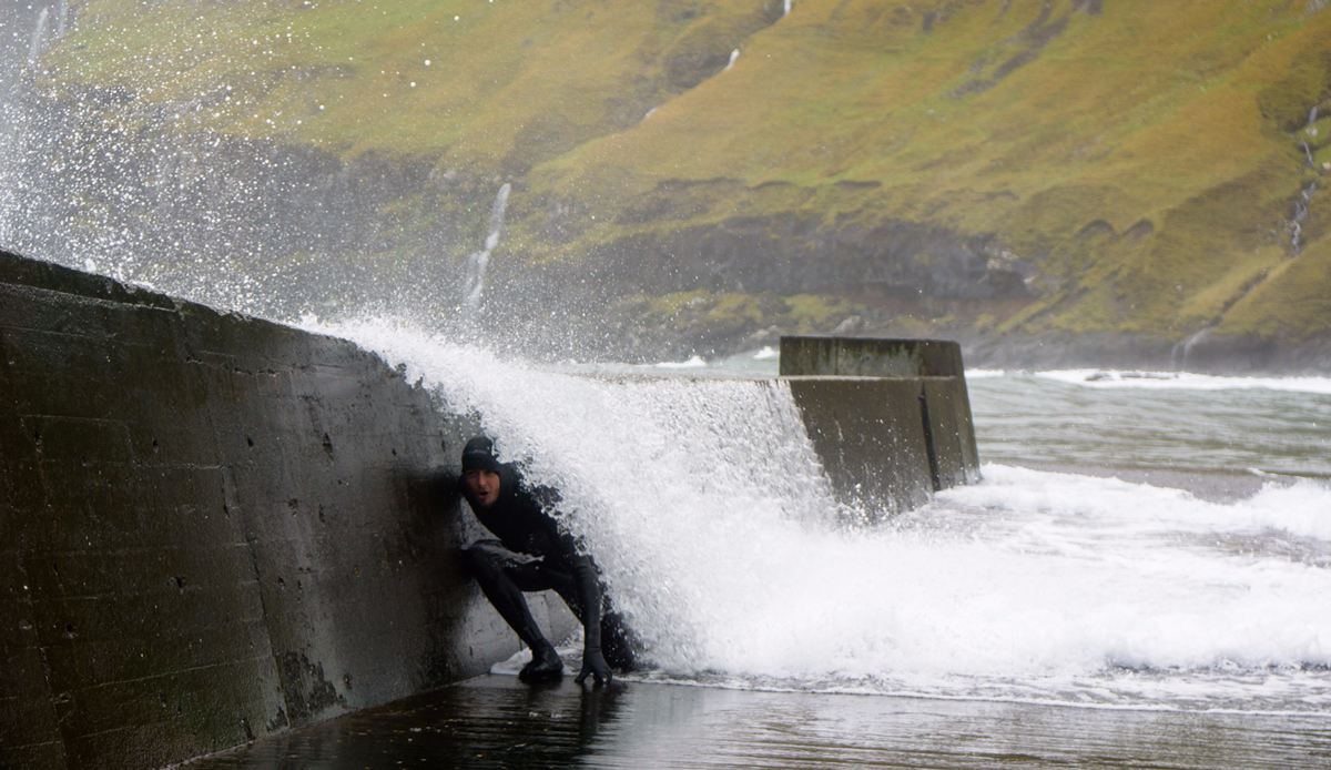 Tyler Warren Getting barreled by storm swell hitting the breakwater in the Faroe Islands. This breakwater also serves as a deck for whaling in the summer. Photo: <a>Chris Burked</a>