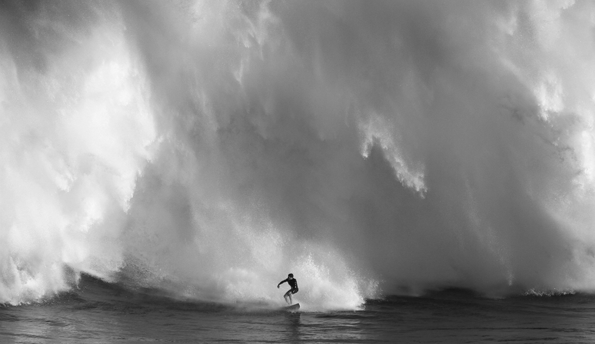 Nathan Florence out running Pe\'ahi by @aaronlynton