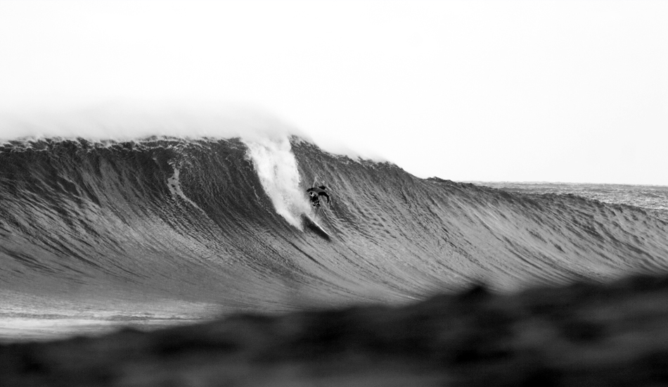 """Another black and white shot, now from Hawaii. I think it\'s Aamion Goodwin. The wave is Pipeline for sure! Image: <a href=\""""http://www.luizblanco.com/Home.html\"""" target=\""""_blank\"""">Blanco</a>"""