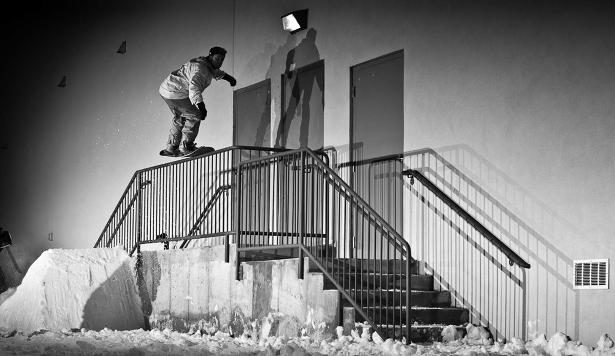 "I find it quite entertaining, even after all of these years shooting in the streets; how snowboarders utilize every type of handrail that was designed and implemented in the name of public safety; for freestyle snowboarding. Take this standard set of stairs on the backside of a strip mall in Anchorage, Alaska, which is used on a daily basis for deliveries and cigarette breaks. For us, we see them hosting freestyle maneuvers in the wee-hours of the morning for guys like Ethan Deiss, who prefer a 'nosepress fronside 270 to downbar' to a Marlboro Light at 3pm. Photo: <a href=""http://deanblottogray.com/\"">Blotto</a>"