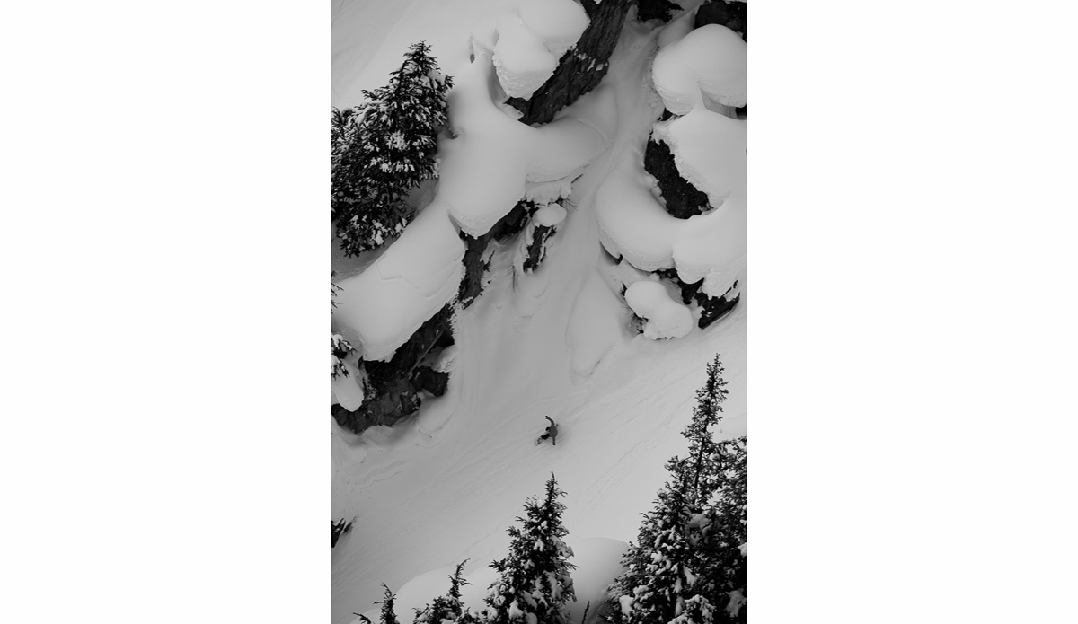 """Swiss snowboarder Frederik Kalbermatten closes out a long powder run through an oversized gully at the bottom of the mountain…everything is bigger in Alaska. Photo: <a href=\""""http://deanblottogray.com/\"""">Blotto</a>"""