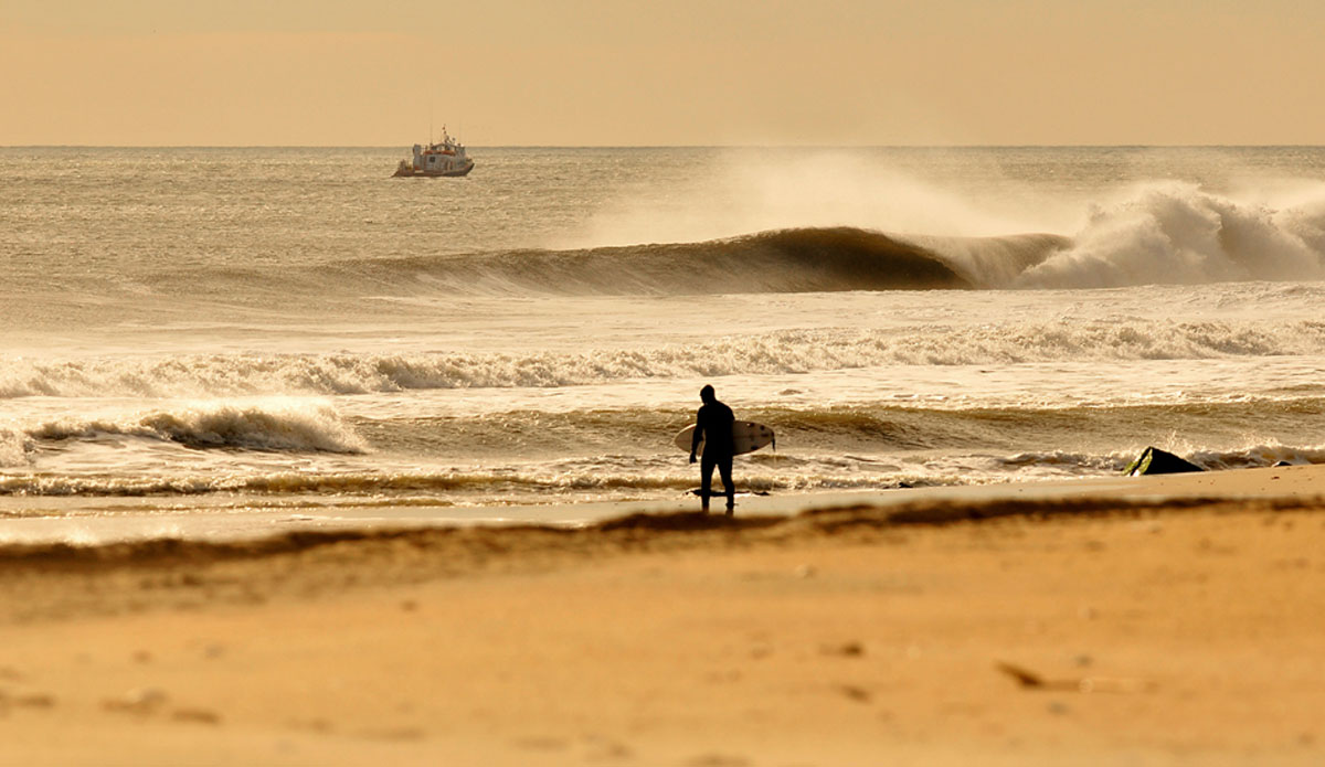 "At first light. Dawn patrol at the Jersey Shore. Photo: <a href=""http://jerseyshoreimages.com/about.html\"">Robert Siliato</a>"