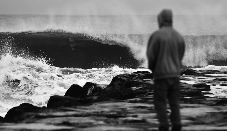 """Surfer contemplating whether it\'s worth it to run back to the truck and put on the 5 mil. Photo: <a href=\""""http://jerseyshoreimages.com/about.html\"""">Robert Siliato</a>"""