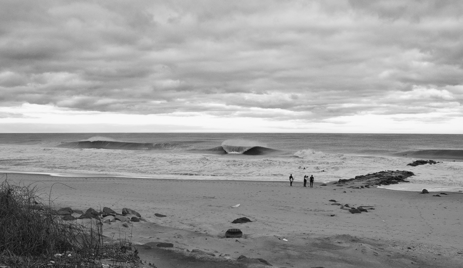 """Unknown surfers watching the waves in Long Branch, New Jersey. Photo: <a href=\""""http://jerseyshoreimages.com/about.html\"""">Robert Siliato</a>"""