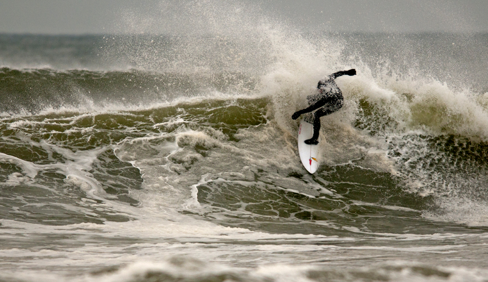 """Unknown surfer throwing some frothy spray. Photo: <a href=\""""http://jerseyshoreimages.com/about.html\"""">Robert Siliato</a>"""