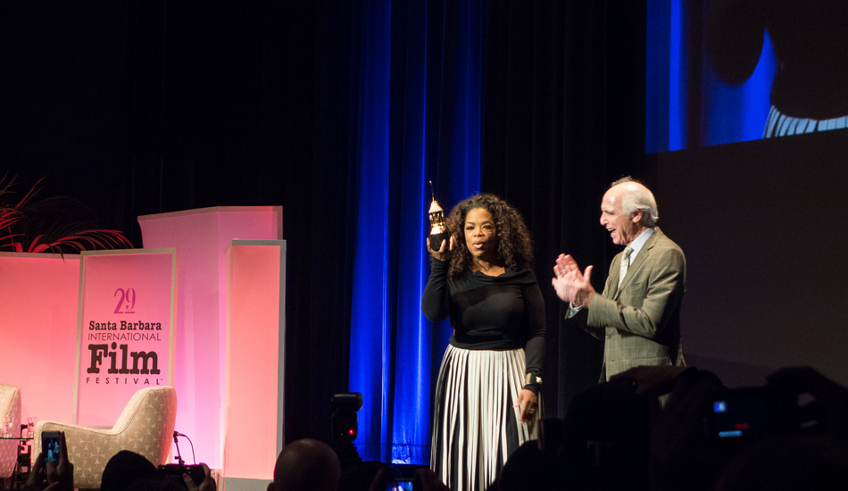 "Oprah received the Montecito Award, which was created in recognition of a performer who has given a series of classic and standout performances throughout her career. When asked on the red carpet what her childhood birthday parties were like, she snapped with a kind smile, ""We never had any parties, we were too poor to have anything like that."" Oprah's mom and grandmother were both maids their entire lives and her great grandmother was a slave. Filming for \""The Color Purple\"" changed her life, it helped her release herself to grace and it created the inspiration to start her Oprah show to uplift people to see the light inside themselves. Photo: <a href=\""http://lowtiderising.com/\"" target=_blank>Branden Aroyan/lowtiderising.com</a>"
