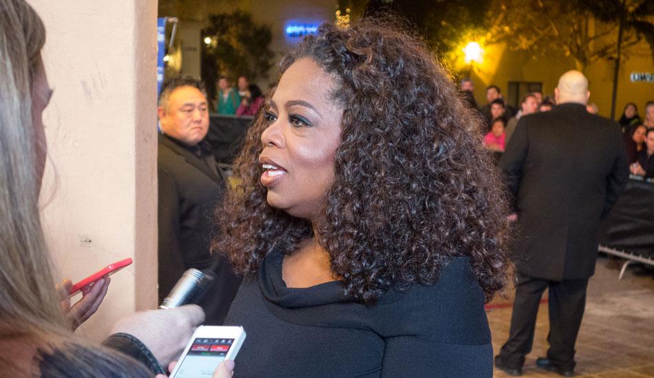 "Oprah taking questions on the red carpet. Photo: <a href=\""http://lowtiderising.com/\"" target=_blank>Branden Aroyan/lowtiderising.com</a>"