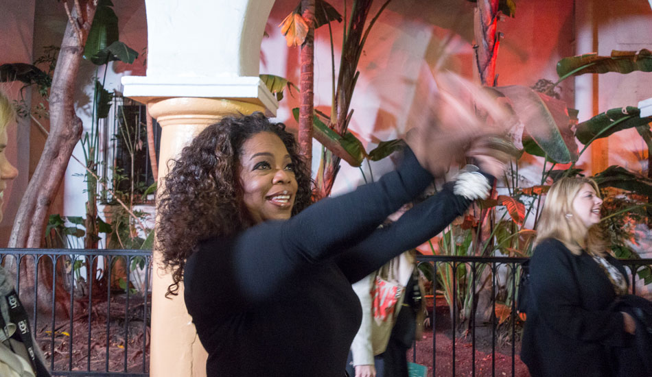 """Oprah waving to the camera with a live feed to the audience inside the Arlington before taking her seat. Photo: <a href=\""""http://lowtiderising.com/\"""" target=_blank>Branden Aroyan/lowtiderising.com</a>"""