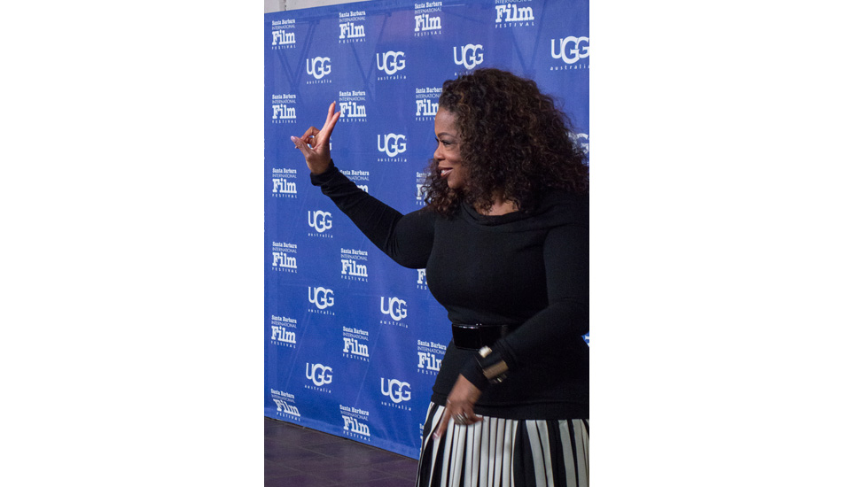"""Oprah received the Montecito Award, which was created in recognition of a performer who has given a series of classic and standout performances throughout her career. When asked on the red carpet what her childhood birthday parties were like, she snapped with a kind smile, """"We never had any parties, we were too poor to have anything like that."""" Oprah's mom and grandmother were both maids their entire lives and her great grandmother was a slave. Filming for \""""The Color Purple\"""" changed her life, it helped her release herself to grace and it created the inspiration to start her Oprah show to uplift people to see the light inside themselves. Photo: <a href=\""""http://lowtiderising.com/\"""" target=_blank>Branden Aroyan/lowtiderising.com</a>"""