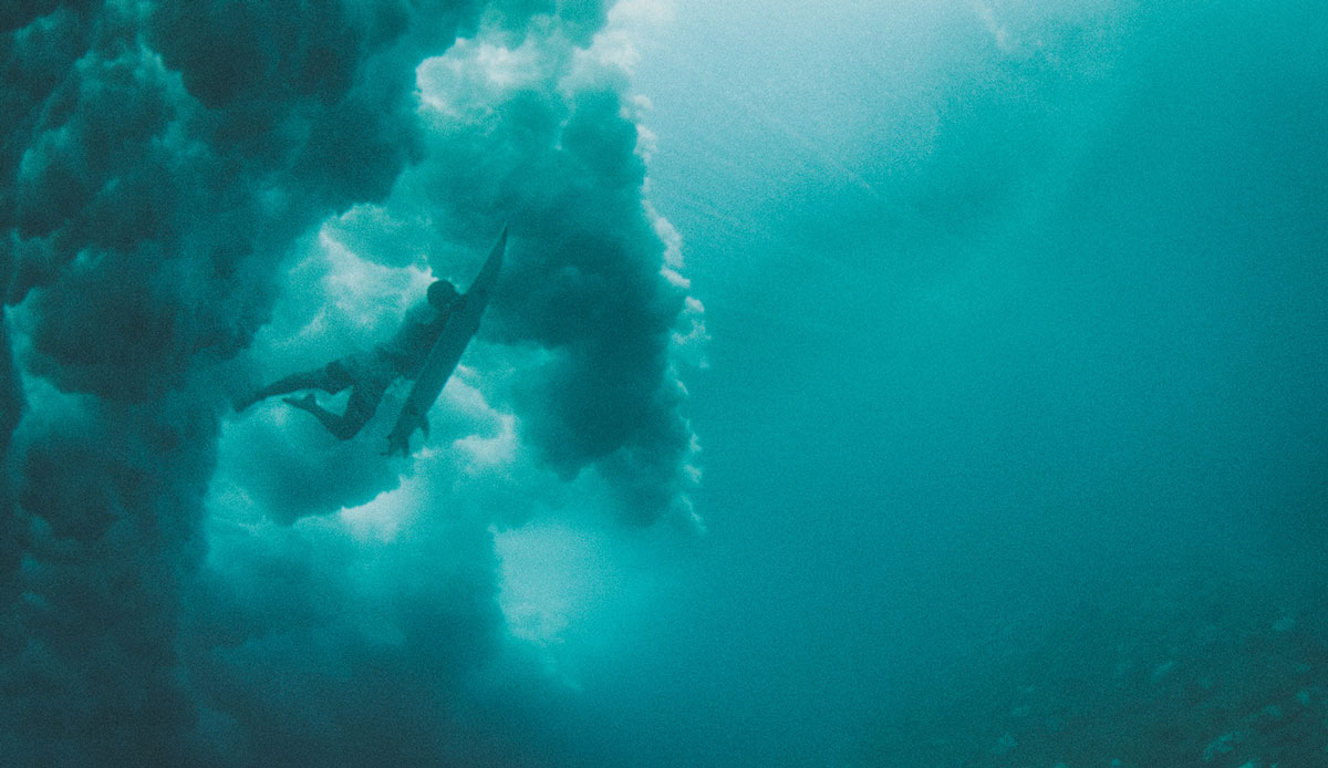 "Big surf duckdive. Photo: <a href= \""http://joaobracourt.com/\"" target=_blank>Joao Bracourt.</a>"