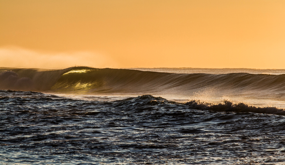 "Morning barrels tinted in the harsh morning sun. Photo: <a href=""http://brentonderooy.com/\"">Brenton de Rooy</a>"