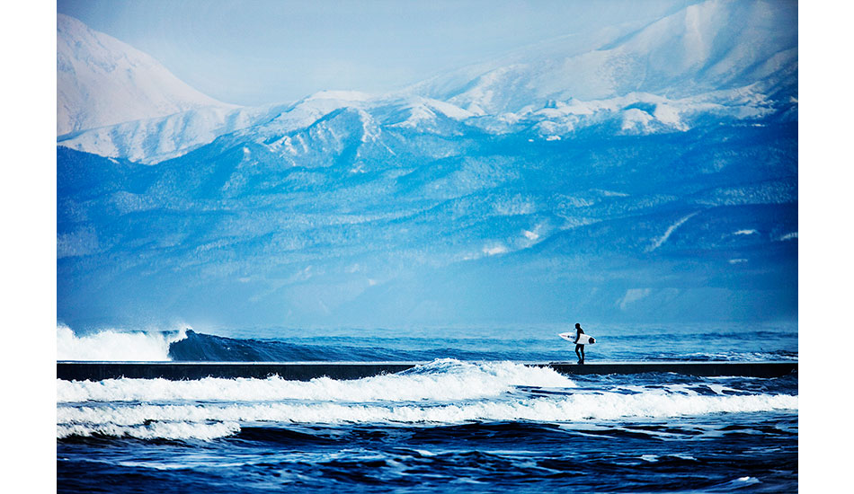 "Dan Malloy walking down a jetty straight into the lineup in Japan. Photo: <a href=""http://www.briannevins.com/\"" target=_blank>Brian Nevins</a>"