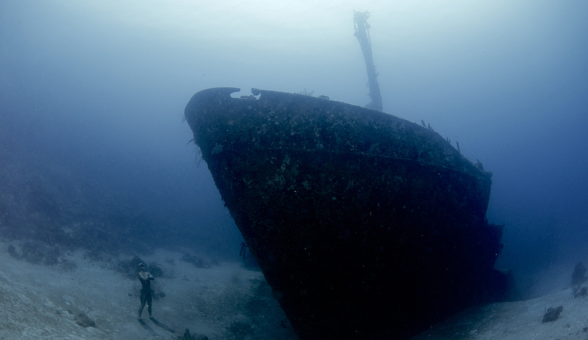 "Alexey Molchanov standing at 110 feet, looking up at the Aguila wreck off Roatan, Honduras. Photo: <a href=""http://liabarrettphotography.com/\"" target=_blank>Lia Barrett</a>"