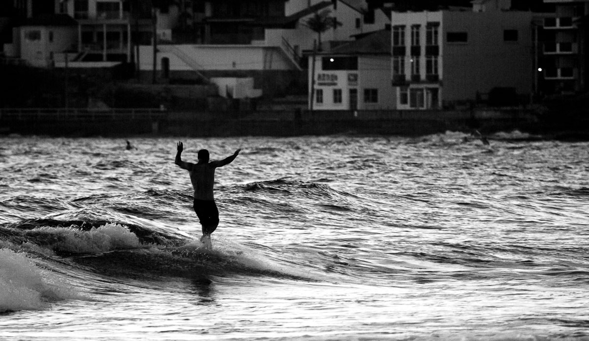 """A lot of the swell tends to pass trough on the horizon here at Manly beach. But there hasn\'t been a day where I\'ve come down to shoot the waves, surf, ocean or beach life where there wasn\'t anyone surfing. Even the smallest stuff is good enough for some guys. Love the enthusiasm. Photo: <a href=\""""http://www.SurfLove.com.au/\""""> Chris Eyre-Walker.</a>"""