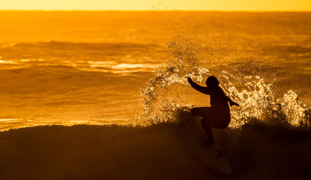 """This guy just made the ocean look like pure gold. Photo: <a href=\""""http://www.SurfLove.com.au/\""""> Chris Eyre-Walker.</a>"""
