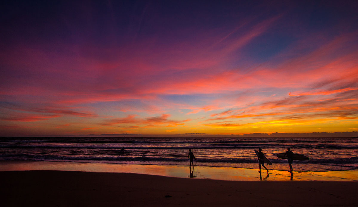 """Spring is the best time in Sydney for colourful sunrises. This shot just beautifully captures that feeling of being the first ones out on a morning session. Surf or no surf, a sky like this even manages to impress the toughest surfers out there. Photo: <a href=\""""http://www.SurfLove.com.au/\""""> Chris Eyre-Walker.</a>"""