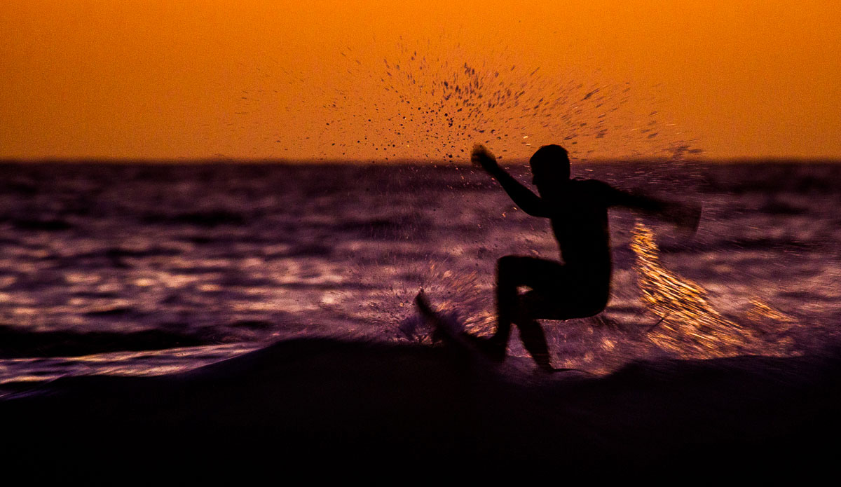 """An early bird surfing at sunrise. I get up most mornings as long as I know that at least there is good surf or a sunrise - when both happen at once things get really fun.  Photo: <a href=\""""http://www.SurfLove.com.au/\""""> Chris Eyre-Walker.</a>"""