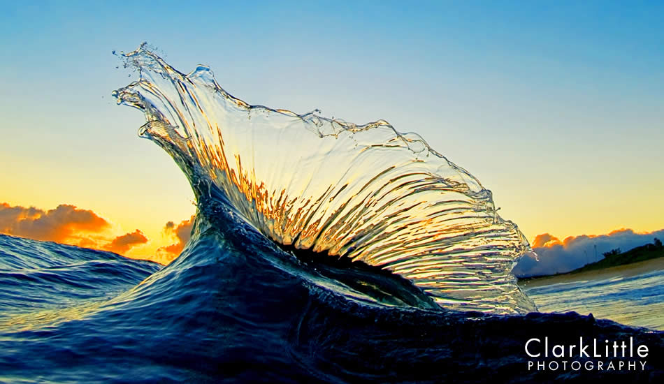 """Backwash wave hits an incoming wave, throwing a glass arch into the sunrise colors. National Geographic used this as a two page spread last summer. The Limited Edition print sold out quickly. Photo: <a href=\""""http://ClarkLittlePhotography.com\"""" target=_blank>Clark Little</a>."""