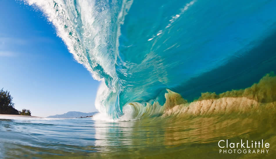 "A large North Shore wave makes its way into a shallow sand bank, sucking the sand off of the sea floor into the wave itself. Photo: <a href=""http://ClarkLittlePhotography.com\"" target=_blank>Clark Little</a>."