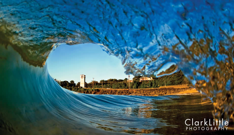 """Waimea Bay shorebreak with the iconic church tower framed in the tube. It all began with surfing this wave. The surfboard morphed into a camera. Photo: <a href=\""""http://ClarkLittlePhotography.com\"""" target=_blank>Clark Little</a>."""
