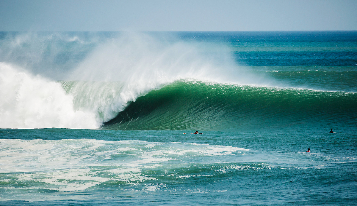 """The Outer Reef at Popoyo in Nicaragua. I shot this in May of this year (2015) during the huge south swell we got at the beginning of the month. I booked my ticket the night before the peak of the swell and arrived to this the next morning straight off the plane. This shot makes the wave look a lot more perfect than it really is. What you don't see here is the boils on the face in the take off zone, steps that need navigating and wide sets that can clean you up and smash you into the sharp ledgy reef which is only a few feet below the surface. Wave selection is critical and it was quite the experience to see this spot going off. Photo: <a href=\""""http://evanconwayphoto.com/\"""">Evan Conway</a>"""