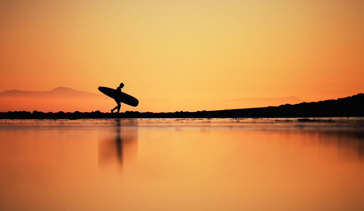 ""\""""The walk out   after a long day can be one of the most satisfying parts of surfing."""" Photo:<a href=""""http://www.paulgreenephoto.com/""""> Paul Greene.</a>""1200|695|?|en|2|7122d0bde5921ffd9d159b111bcb784a|False|UNLIKELY|0.2808259129524231