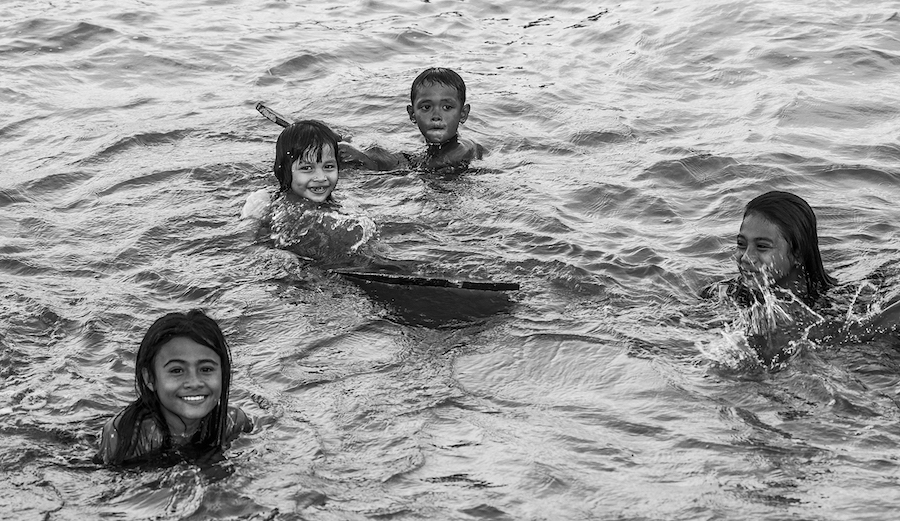 Local girls learn to surf in remote Indonesia, 2018. Photo: Fran Miller