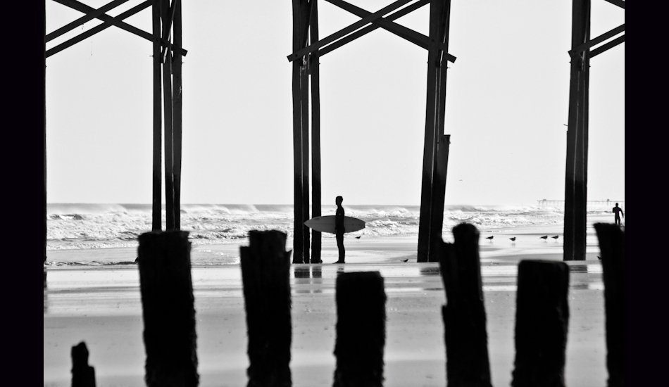 """Carolina Beach, NC, 2011. A lonesome surfer paddles out to catch swell at a local spot called \""""Sunskipper\"""". Photo: <a href=\""""http://www.chrisfrickphotography.com/\"""" target=_blank>Chris Frick</a>"""
