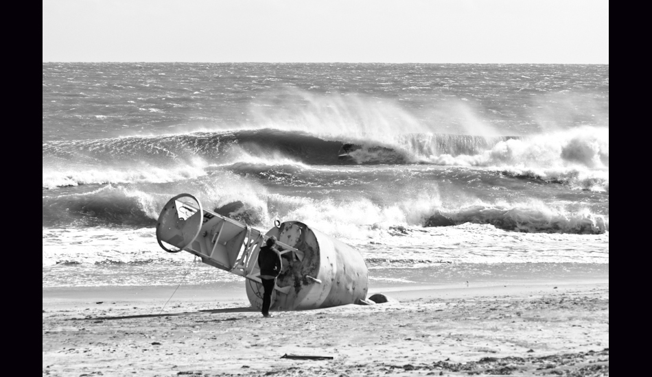 """S Turns. OBX, NC 2011. Charlie Weatherby tucked into a drainer. Since Hurricane Sandy, this spot no longer exists. Photo: <a href=\""""http://www.chrisfrickphotography.com/\"""" target=_blank>Chris Frick</a>"""