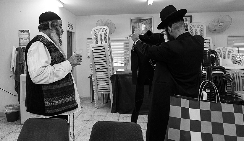 "Meir showing off his new wetsuit to a friend in ""Orut Hatorah\"" synagogue in Bat Yam."