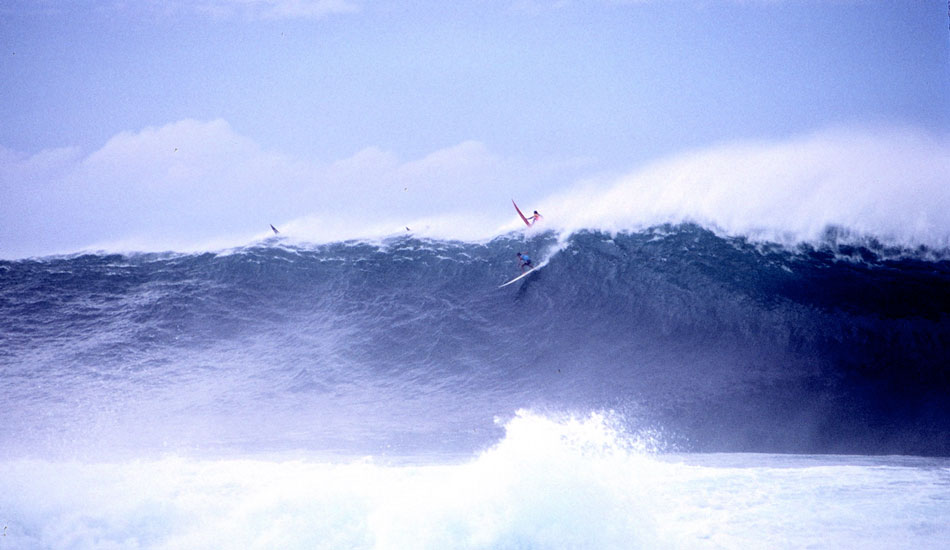 One frame from Buzzy Kerbox\'s sequence of Brock Little at the 1991 Quiksilver in Memory of Eddie Aikau. January 21, 1990: The 1990 Quiksilver in Memory of Eddie Aikau remains one of the great big-wave contests of all time: Kerry Terukina's wipeout, Brock Little's tuberide, Keone Downing's clean strategy and Richard Schmidt's finless sideslip and recovery. There are many angles on this huge wave that Brock took off on: Buzzy Kerbox's beach angle, Bernie Baker from the heiau, Scott Winer from somewhere in between. There were lots of photographers on hand that day. Which angle to use? This is one frame of Buzzy Kerbox\'s land angle.  Photo: Buzzy Kerbox