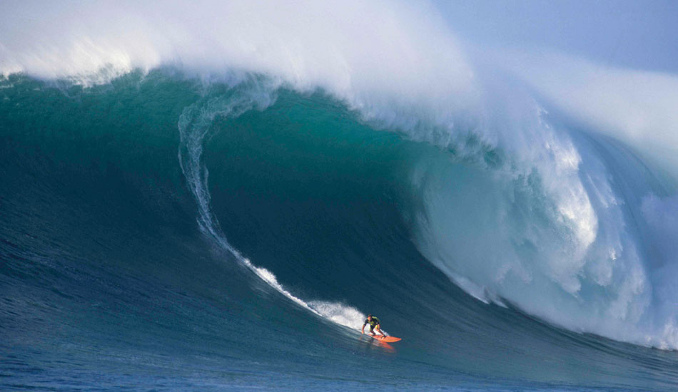 January 28, 1998: Ken Bradshaw on a moose of a big, clean wave at Outside Log Cabins on the Condition Black day. This is not the biggest wave Bradshaw rode that day. That wave came earlier, and was filmed only by Bill Ballard on a Beta machine. Condition Black remains one of the most spectacular tow surfing days ever – even with all that has come since. Photo: Brian Stephens