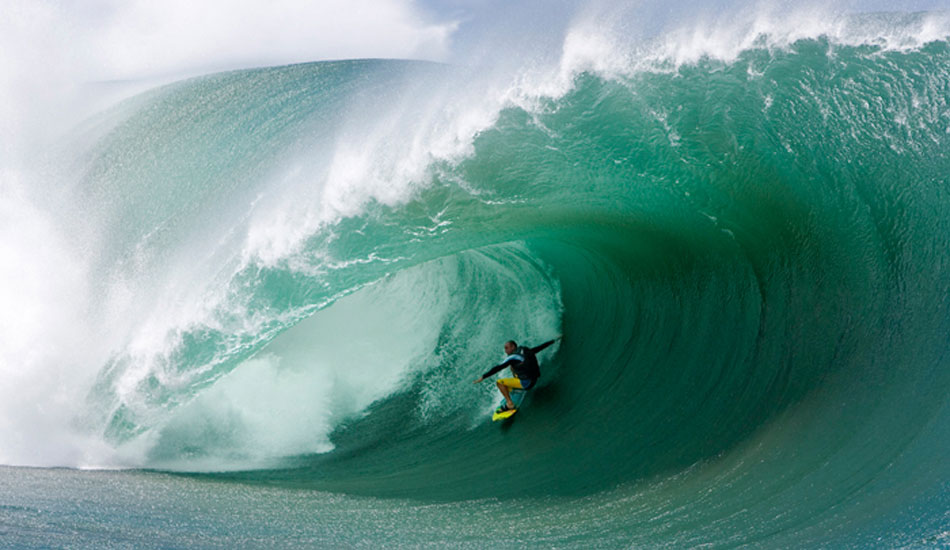 Shane Dorian. Layback at Chopes, inflatable vest in tow. Photo: Fred Pompermayer