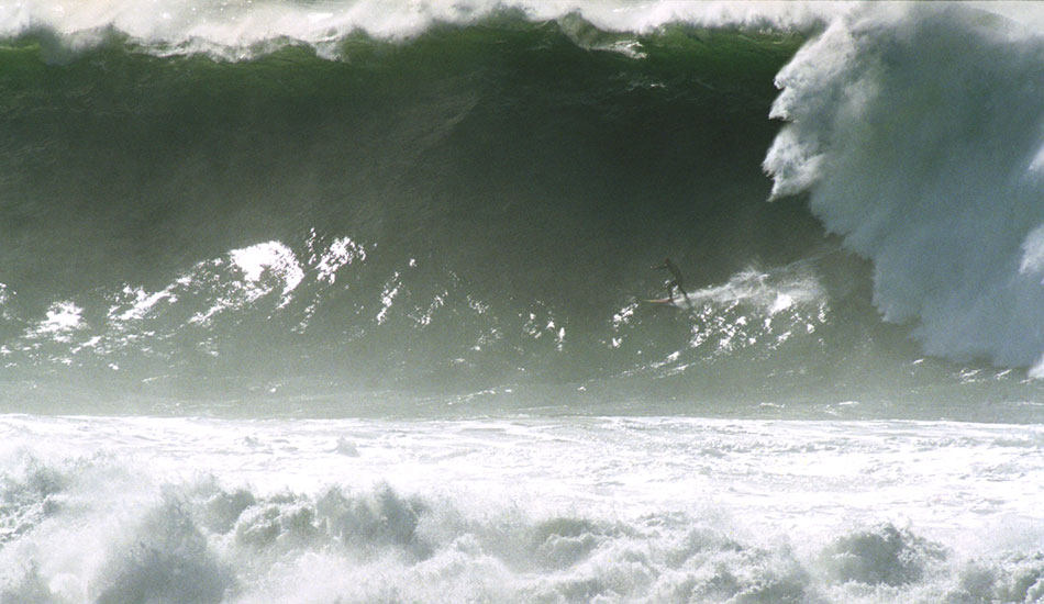 """January 30, 1998: Two days later, the Condition Black swell made it to the west coast, where Mavericks surfers ran into the Unridden Realm. This is the day Neil """"Moose"""" Matthies wiped out hard in the bowl, the day Peter Mel did his best to catch $50,000 bombs, and the day Perry Miller (shown here) and Doug Hansen tried tow surfing at Mavericks – as the regular surfers made noises like Lurch. Photo: George Nikitin"""