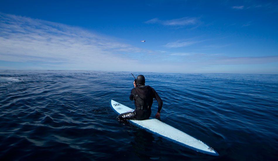 """The Coast Guard  flew by to greet Greg on his return to wish him well. He expressed his gratitude via radio. Photo: <a href=\""""http://www.mavsurfer.com\""""> Frank Quirarte.</a>"""